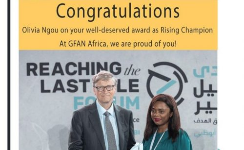Olivia Ngou receives the #ReachAward from Bill Gates
